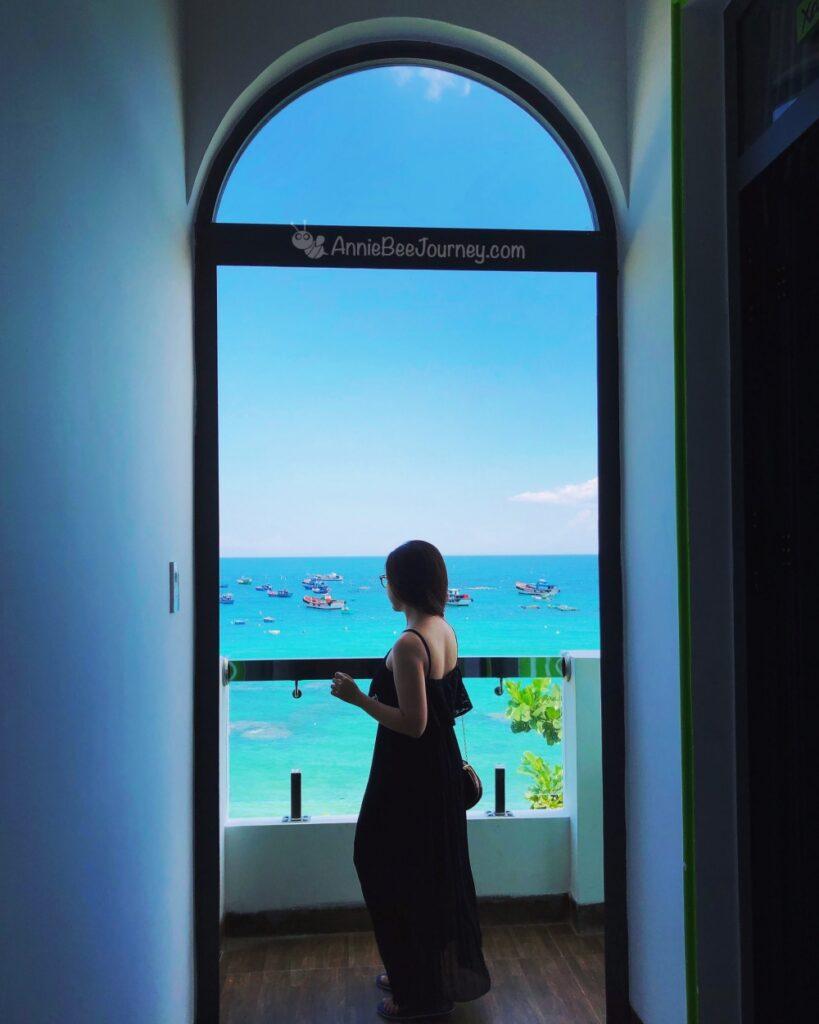 a girl look at the blue beach of Green Island or Cu Lao Xanh, an island in Quy Nhon, a beautiful Vietnam beach