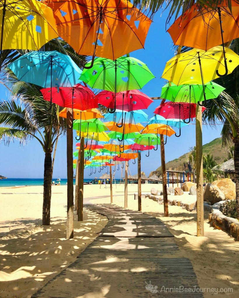 a colorful umbrella road leading to the beach in Ky Co island, Quy Nhon, Vietnam