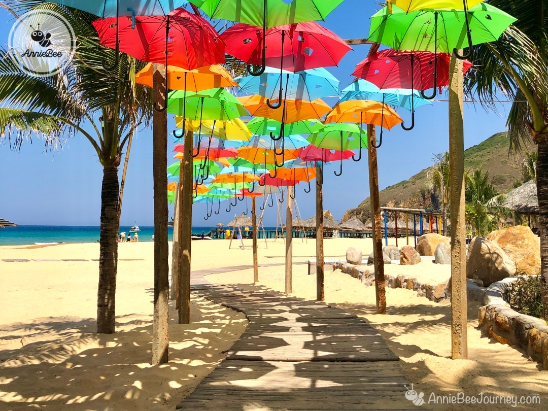 Colorful umbrella path on the beach at in Ky Co island in Quy Nhon, Vietnam