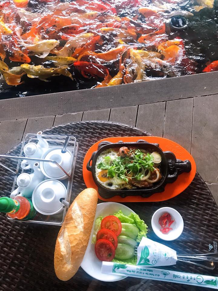 Enjoy meal next to Koi fish pond at Green Cafe in Quy Nhon, Vietnam