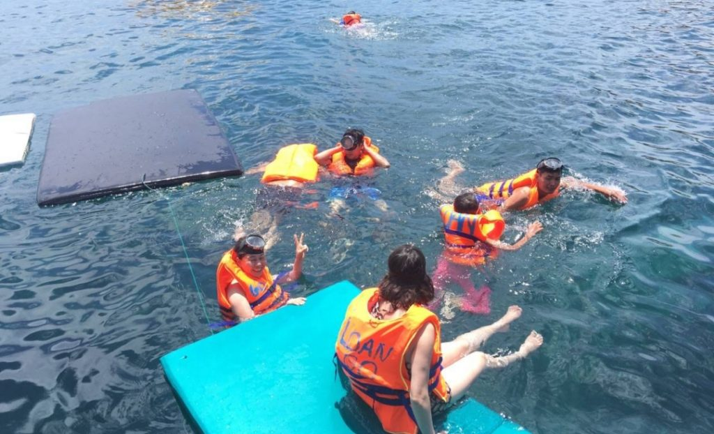 Go snorkeling in floating raft at Ky Co island in Quy Nhon, Vietnam