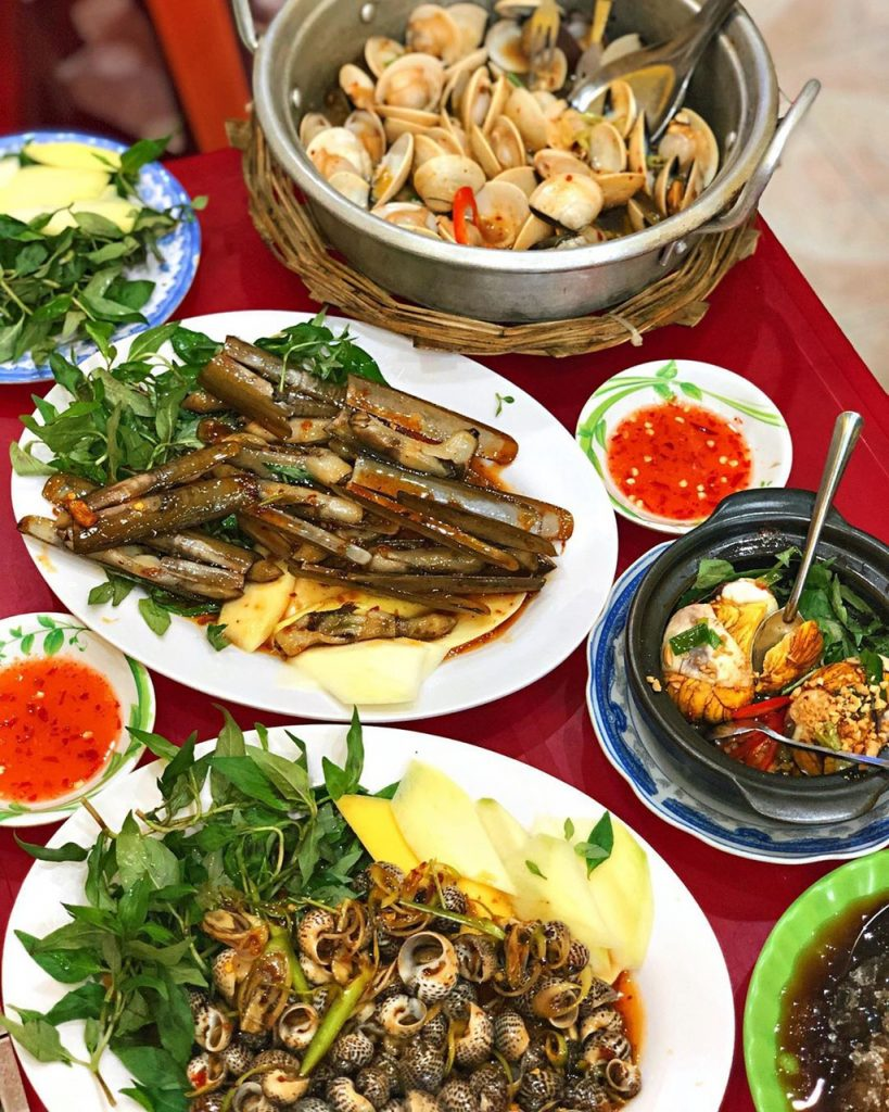 a table of seafood dishes in Quy Nhon, Vietnam