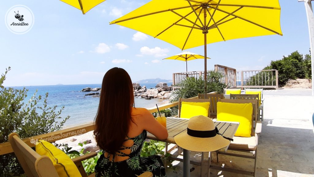 Beach front coffee shop with yellow umbrellas at Trung Luong camping site in Quy Nhon, Vietnam